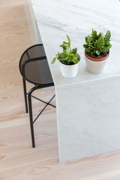 Marble counter with Dinesen douglas fir flooring for private residence by Studio Mills