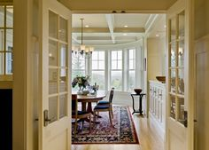 I love the white and the window.  Look at that built in buffet on the right.