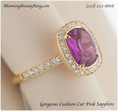 One of the Prettiest Sapphire Rings I have ever seen!  A Halo of diamonds showcases this beautiful Cushion Cut Pink Sapphire in the beautiful setting.  BloomingBeautyRing.com  (213) 222-8868 Sapphire Rings, Sapphire Jewelry, Pink Sapphire, Popular Engagement Rings, Diamond Engagement Rings, Gemstone Colors, Gemstone Rings, Diamond Alternatives, Pink Bling