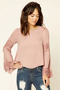 Contemporary - A woven top featuring long bell sleeves with eyelash lace trim, round neckline, curved hem, and buttoned back keyhole cutout.
