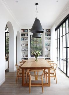 Dining Space Trend - Black Accents - black cone pendant lights, steel frame windowns - wishbone mid-century chairs