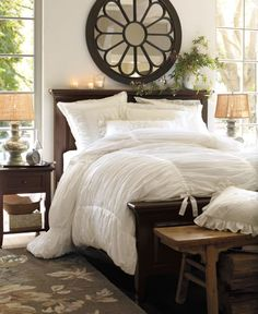 "Bedroom Tip: Next time you buy a comforter, don't buy the size of your mattress. Size UP at least one size, two is better. An oversize comforter whispers, ""Decadence,"" and also helps you and your spouse sleep better, without having to fight for covers. :) -Dark wood and white"