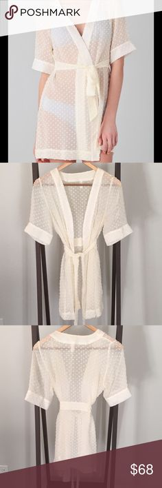 Zinke Ruschmeyer Silk-Chiffon Robe NWOT NWOT. Breathtaking robe designed by Zinkē. This sheer silk-chiffon robe features frayed embroidered dots and a self-belt tie. Double-layer banding at placket and at cuffs. Short sleeves. Zinkē Intimates & Sleepwear Robes