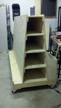 Absolutely love this lumber storage cart. Panels, small parts, long pieces and it rolls! Terrific.