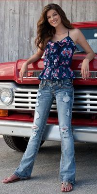 This entire look is fab. I, of course love the jeans because of the style and fit they offer. The destructed and faded style is totally me. The top is cute and flirty and even what you can see of the sandals is cute. The Ford truck and the barn give a down home fealing that reminds me of growing up in North Branch and the whole picture just kind of brings a relaxed country feeling to mind.
