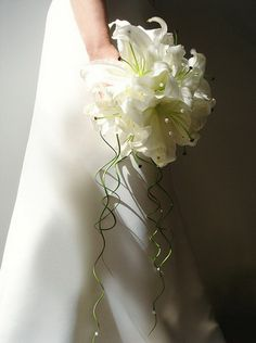 Clean white lilies with pearl pins and curly greenery make this a stunning modern bouquet. Lily Bouquet Wedding, Lily Wedding, Wedding Flowers, Dream Wedding, Oriental Lily, White Lilies, Greenery, Glass Vase, Ivory