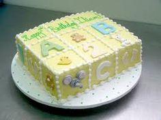 Torta Rectangular cubierta en crema con motivos en fondant