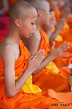 Novice Buddhist monks pray at their ordination at Wat Chedi Luang in Chiang Mai, Thailand.༺ ♠ ŦƶȠ ♠ ༻