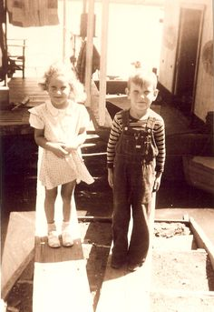My momma Patsy Ann and Uncle Leslie Robert Cox, on the houseboat that they were born on in Golconda, IL.
