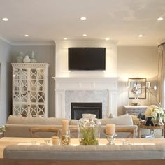 White fireplace Moulding; love the white cabinet in the corner