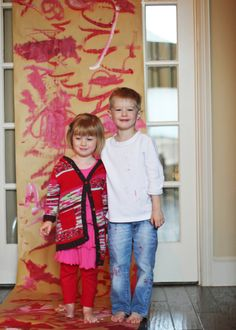 Kid's help wrap gifts for Grandma & Grandpa or Teachers - Graffiti Gift Wrap: Let kids paint a giant roll of kraft paper to use as gift wrap.