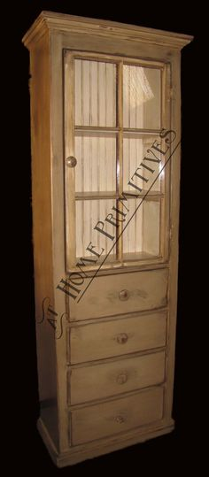 Old window turned side-ways to make a narrow door for this lovely cupboard by At Home Primitives.