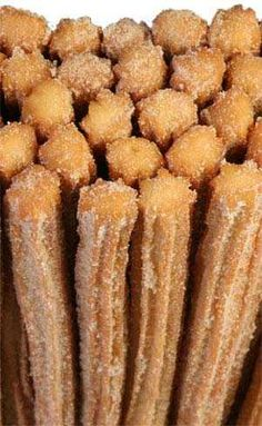 Authentic Mexican Churros Recipe Easier to make with a deep fryer and star tip larger than Wilton which makes them to skinny. Consistency before placing in bag is a big ball of dough that sticks together better than it sticks to the bowl Mexican Dishes, Mexican Food Recipes, Sweet Recipes, Snack Recipes, Cooking Recipes, Snacks, Mexican Desserts, Mexican Bakery, Authentic Mexican Churros Recipe