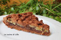 crostata Nutella e banane - INGREDIENTI: 230 g di farina 20 g di cacao amaro 100 g di burro morbido 1 uovo 100 g di zucchero 1 cucchiaino di lievito  nutella 2 banane mature