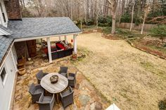 Backyard - 7725 Nesbit Ferry Road, Sandy Springs, GA -Charming Renovated/Updated Cape Cod w/ Tons of Character on a Gorgeous Private Lot! Bright Open Spacious Floor Plan Ideal for Entertain*Kitchen Opens to Family Rm & Walk Out to Vaulted Beadboard Porch Addition w Flagstone Floor & Tranquil Backyard & Fire Pit* KAREN CANNON REALTORS, INC. Specializing in #Dunwoody & #SandySprings - Go to KarenCannon.com to search all homes on the FMLS! Contact us today at 770-352-9658 or…