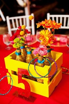 Beautiful table number centerpieces for a carnival themed Bat Mitzvah. | MitzvahMarket.com