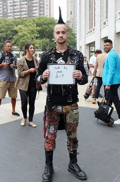 It's wonderful to see that despite the whole studs and spikes fad in fashion that punks still create their own clothes. The only issue I have with his outfit is the jacket looks too new.