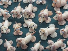 seashell dogs, could use some small driftwood for the body as those shells are hard