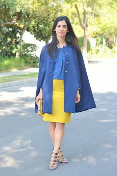 Top things off with a cape. Click to see more street style inspiration!