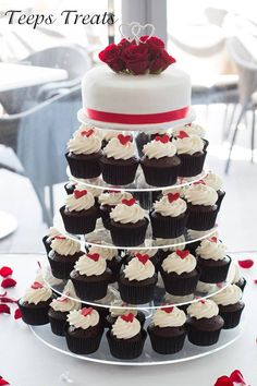 red , black and white cake and cupcake tower wedding...more red rose on top of cake, silver edible beaded ribbon replacing red ribbon, more tiers. (red velvet, chocolate, and vanilla cupcakes)