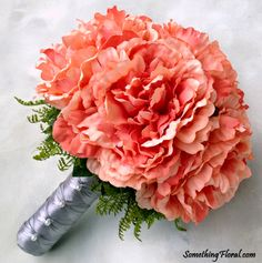 A realistic, artificial floral, coral peony bridesmaid bouquet, accented with fern and a silver grey, satin stem wrap and pearls. Design: Something Floral.  Photo: Urban Fire Studio. #coral #peony #peonies #bouquet #bridal #bridesmaid #grey #silver