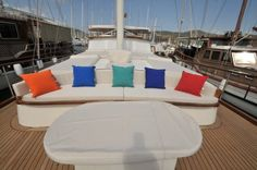 Colorful pillows on a Turkish gulet's front deck. Relax! http://www.guletvoyage.com/ms-310-gulet-yacht.html