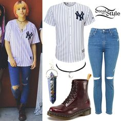 Nia Lovelis posed with her band Hey Violet wearing a jersey similar to the Majestic New York Yankees Replica MLB Jersey ($38.50), her Topshop MOTO Ripped Jamie Jeans ($75.00), Dr. Martens Vegan 1460 W 8-Eye Boots ($129.95) in Cherry Red Cambridge Brush, the Bad Witch Boutique Calypso Necklace ($16.23+) in Lapis Lazuli, and a Bad Witch Boutique Moon Face Choker ($11.80).
