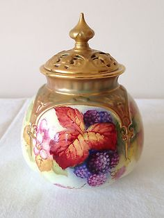 Small rare Royal Worcester handpainted lidded potpourri container signed K.  Blake.