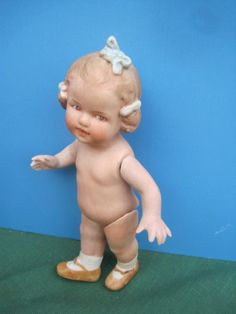 Gebruder Heubach  All bisque Coquette blue bows jointed arm legs