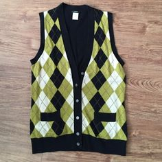 J. Crew Argyle Sweater Vest Great condition! Material shown on third picture. Perfect to dress up for work. J. Crew Sweaters
