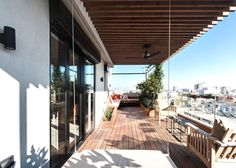 Toledano Architects inserts steel staircase into Tel Aviv penthouse