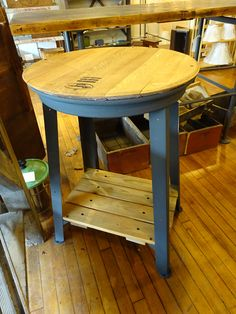 This is a very interesting table, Wine barrel top,break away truck rim and industrial base!