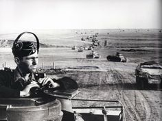 Steppenskizze über alles ( German for Steppes Delineation/Region Over All ) | March 1942, Panzer III kommandeur ( commander ) peers through his armor copula into panoramic rolling steppes of Ukraine in southern Soviet Union, as encountered by 3rd Panzer Division drive towards Caucasus region