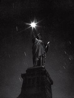 The Statue of Liberty, photographed during a blackout in 1942 — an eloquent expression of the nation's mood in the first full year of a global conflict with no real end in sight.
