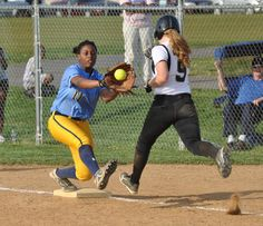 Cape junior first baseman Tiara Duffy catches the ball just in time to force out Sussex Tech's Lauren Genshaw during the Vikings' 6-5 loss in 11 innings April 9. Click softball photo to read entire sports article: Vikings rally, but fall to Tech in 11 innings by Nick Roth