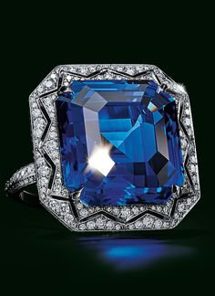 Beautiful Jewelry This magnificent ring features an esteemed Sri Lankan emerald-cut sapphire of over 24 carats surrounded by round brilliant diamonds. - Browse The 2017 Blue Book Bijoux Art Deco, Art Deco Jewelry, Gems Jewelry, High Jewelry, Silver Jewellery, Silver Ring, Sapphire Jewelry, Diamond Jewelry, Blue Books