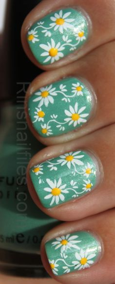 Stamp flowers and add yellow dots with a dotting tool. Stamping nail art. Cute spring manicure.