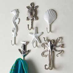 Whimsical wall hooks add a hint of beach-house style to the bath, entry or mudroom. Crafted of solid brass with a nickel-plated or white powder-coated finish.