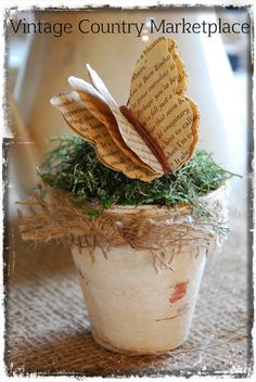Vintage Country Style: Tutorials  Take 4 pages from a $ Store book & brush over pages with a strong cup of coffee.  Place pages in 200 degree oven & bake until dry.  Using this butterfly template, cut out 4 butterflies from your aged book pages.  Tie together with hemp cord or twine