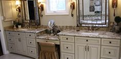 His and her vanities with Merillat cabinets and granite countertops.