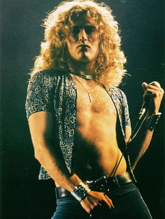 Robert Plant, 1975.  Seeing Led Zeppelin in the early 70's was a religious experience.  This pictures gives some idea of why.