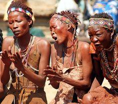 San women singing a healing dance.