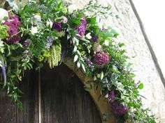 Church arch flowers. Instead of leaving these on the church they could be transferred to marquee and laid along front of top table. Would mean you didn't need to spend on other flowers there.