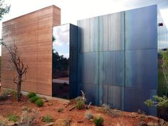 Rammed earth, glass and steel