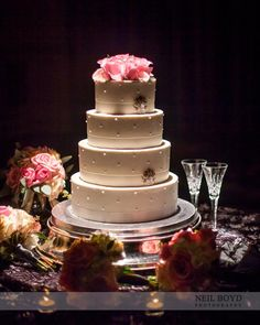 White wedding cake with pink roses. Raleigh weddings.