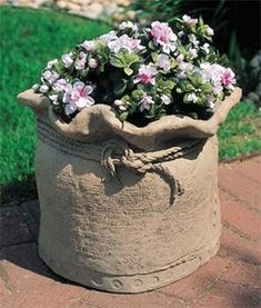 Burlap Sack Flower Planter Made of Concrete. Maybe use burlap sack and use draped concrete method.Bring home this burlap cement sackThese decorative concrete flower planters have a charming and unique style that is perfect for walkways, building peri Diy Concrete Planters, Concrete Crafts, Concrete Garden, Diy Planters, Precast Concrete, Garden Planters, Flower Planters, Flower Pots, Succulent Planters