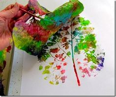Leaf Painting- Find those wonderful huge fall leaves... smatter in a variety of colors...and gently roll onto paper...