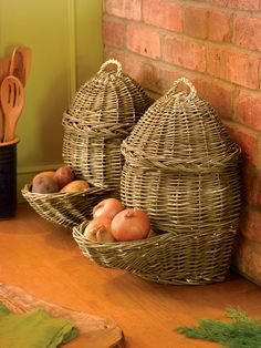 Countertop Potato & Onion Storage Baskets, Set of 2. Breathable woven baskets like these, used for centuries in Europe, shield the contents from light and keep potatoes and onions fresher longer. These have flat backs so they fit nicely on a counter. Fill them from the top with up to 8 pounds of vegetables, then dispense from the pocket below. Natural willow baskets with sea grass handles add a little country style to your kitchen or pantry.