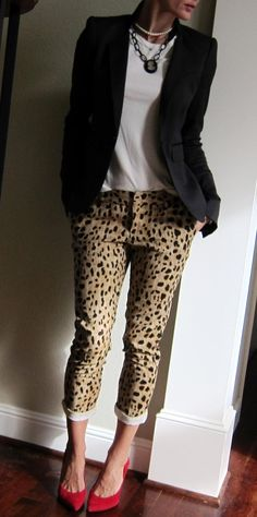 printed pants, white top, black blazer and red pumps