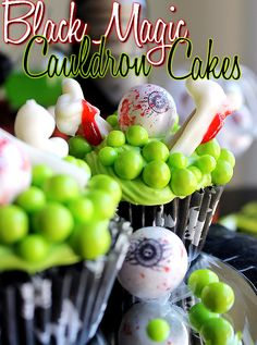 Black Magic Cauldron Cupcakes with Lime Green Sixlets, Gumball Eyebals, and chocolate Pretzel 'Bones.' #SweetworksFall #ad